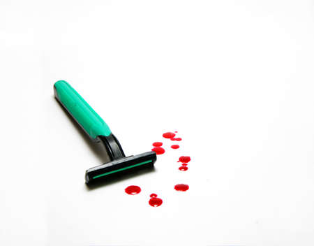 Razor with drop of blood                   photo