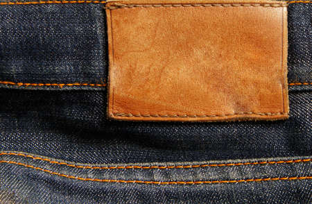 blue jeans: Blank leather jeans label sewed on a blue jeans. Can be used as background for your text.