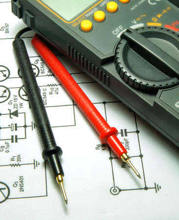 ammeter:    Checking Circuit by Multi-Meter. Electrical Engineer on during checking circuit board unit by Multi-Merer.