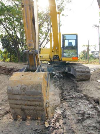 shovel in dirt:  A huge shovel digging in dirt
