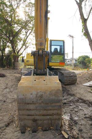 A huge shovel digging in dirt Stock Photo - 11804641