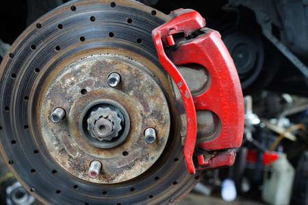 brake caliper: Rusted disc brake and caliper on car