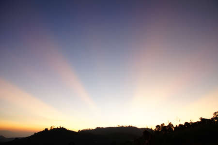 Twilight sky in purple over the mountain photo