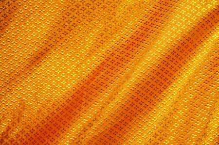 softness: Golden satin, silk, waves. Yellow background