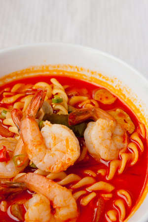 Spaghetti tom-yum seafood closeup photo