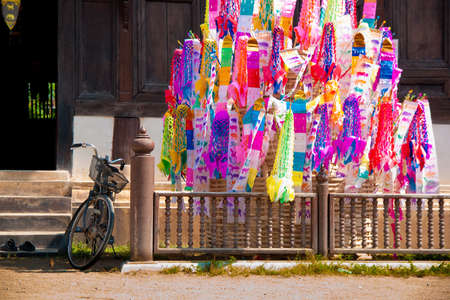 Many Color paper flag in temple of Thailand,For Buddha worship photo