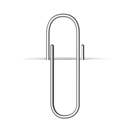 Metal clip, paperclip on white paper