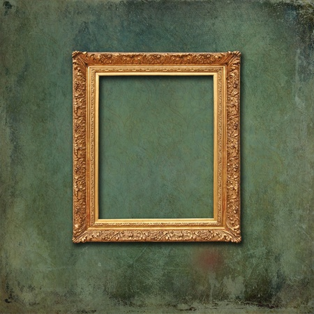 Empty golden vintage frame on a scratched grunge wallpaper with faded design  photo