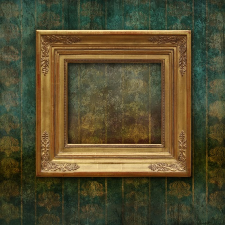 Golden classic frame on a faded and scratched Victorian floral texture photo