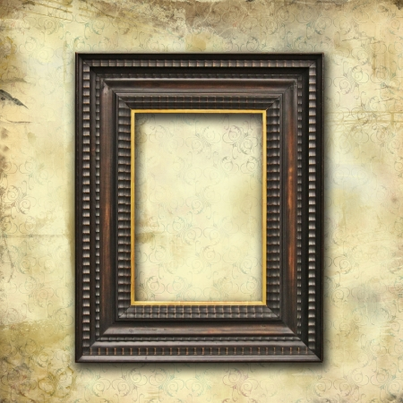 grunge faded wallpaper with old art deco empty frame photo