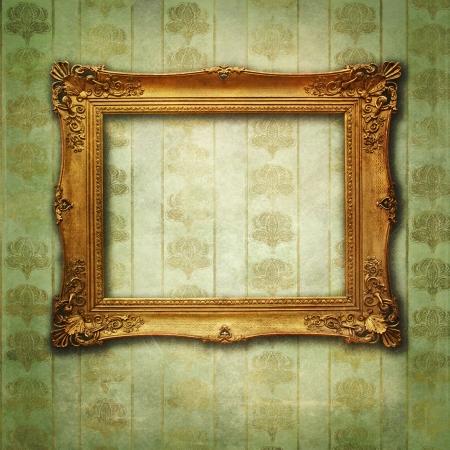 黄金の旧式な空のフレームと色あせた花グランジ壁紙