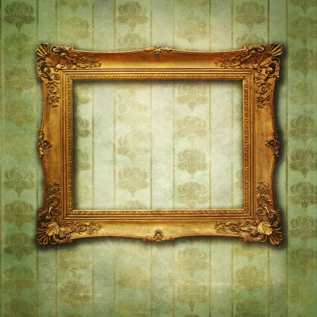 grunge floral faded wallpaper with golden antique empty frame photo