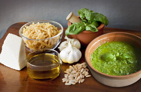 Excellent and easy Italian recipe  noodles with pesto alla Genovese, aromatic sauce of olive oil, basil, parmesan, garlic and pinenuts  photo