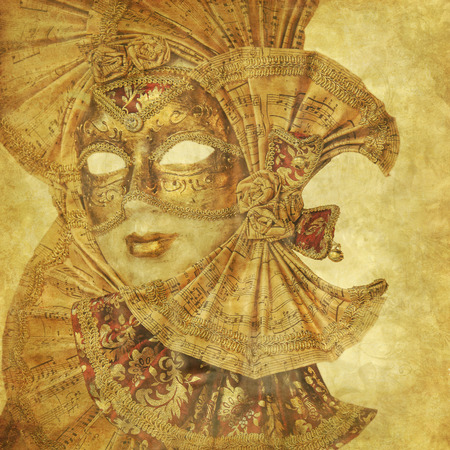 Beautiful Venetian golden mask on a grunge floral background