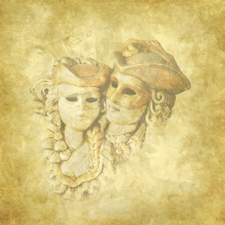 Golden grunge and floral background  with antique Venetian masqueraded lovers  photo