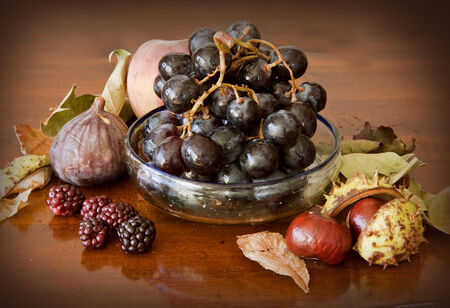 nonfat: An assortment of autumnal fruits: ripe figs, grapes, blackberries and chestnuts Stock Photo