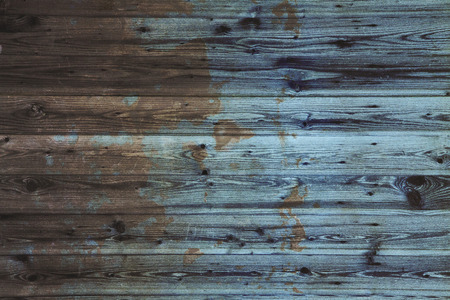 Background of painted, stained and dilapidated wood Stock Photo