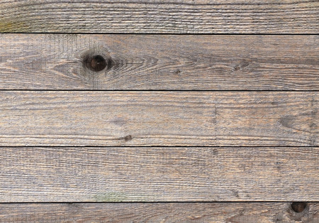 Horizontal wooden plank with knots, pattern of natural aged color. Stock Photo