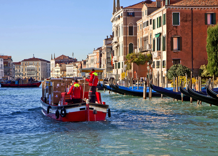 the merchant of venice: VENICE, ITALY, Merchandise traffic on Grand Canal in Venice at working days: small and convenient cargo boats transport goods to destination.