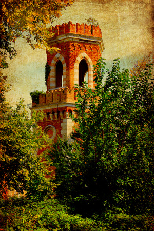 Venice, old Arsenal guard tower framed by  wild green vegetation. Vintage and grunge textures added. photo