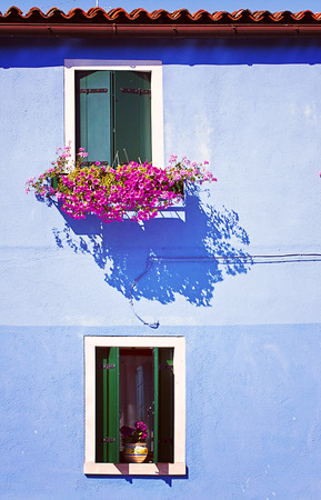 vase plaster: Blue house facade in Burano, small fisher island near Venice Stock Photo
