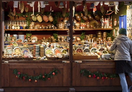 Christmas market in central Munich, Germany. Booth with pottery, dishware, ceramics and seasonal decorations.