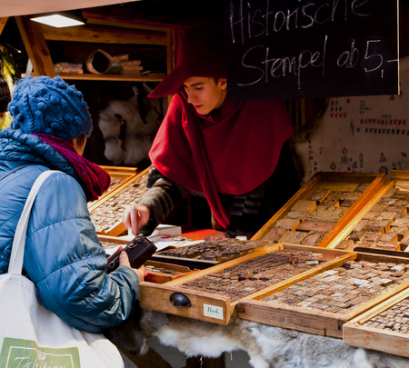Traditional Medieval Christmas market ( Mittelaltermarkt) at Wittelsbacher Platz in Munich.