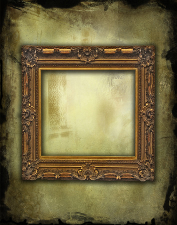 vintage wooden golden frame on grunge faded texture photo