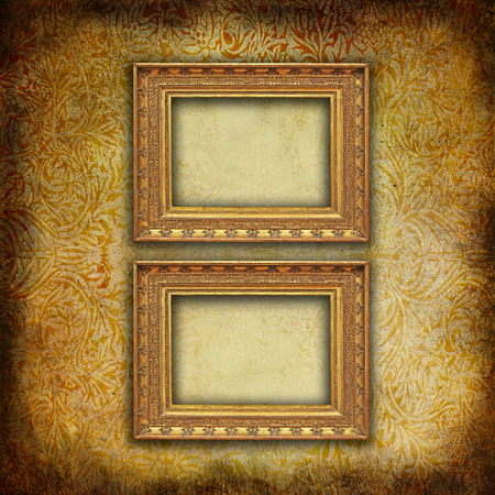 grunge floral faded wallpaper with two golden antique empty frames photo