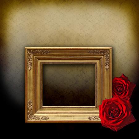 Vintage golden frame on an elegant golden background with two roses photo