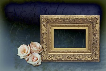 elegant velvet blue wallpaper, empty antique golden frame, three light pink roses photo