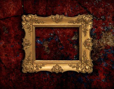 Precious golden vintage frame on red grunge background photo