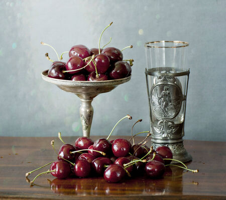 pewter: Vintage silver objects and ripe red cherries Stock Photo