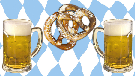 Symbolic representation of Oktoberfest, famous beer festival in Munich: the Bavaria colors and pattern, pretzels and beer. Skoal! Stock Photo