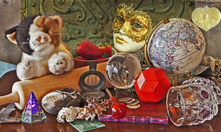 mishmash: Like in an hidden objects game, a mishmash of different paraphernalia:tools, toys, food, shells and memories of the past on a grunge environment.