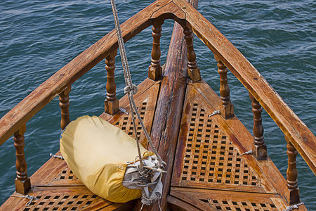 prow: Vintage yacht ready to sail with sailbag on the prow wooden deck. Instagram retro filter added Stock Photo