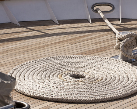Yacht deck with anchor line in spiral shape