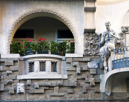 faun: Trieste, Italy - Art nouveau building  decorated with faun statue playing flute
