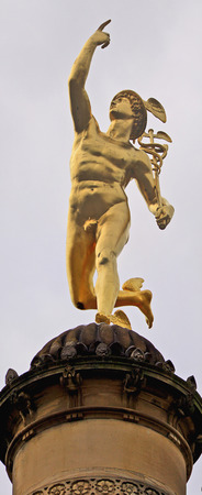 old mercury: Stuttgart, Germany - golden Hermes statue on a column near Schlossplatz