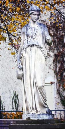 vestal: Stuttgart, Germany - mythological classical statue by Bertel Thorvaldsen (1770 ? 1844) in public Schlosspark with autumnal leaves. Stock Photo
