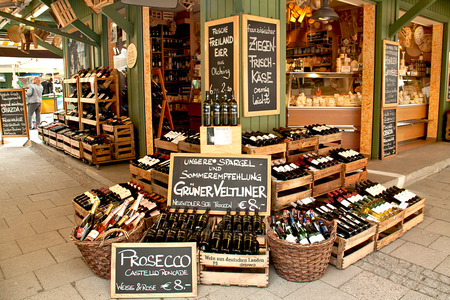 wine trade: a gourmet food and wine shop offers international specialties at Viktualien Markt famous touristic attraction Editorial
