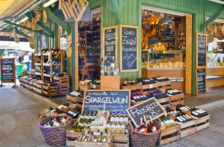 MUNICH, GERMANY. Viktualien Markt open air market in Munich center is a shopping landmark in Munich center and offers daily gourmet delicacies and wines to  local buyers and tourists 에디토리얼