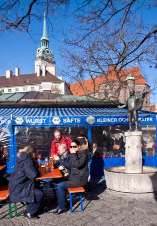 biergarten: MUNICH, GERMANY: people seat and drink beer open air at Viktualien Markt in Munich in a sunny  winter day.