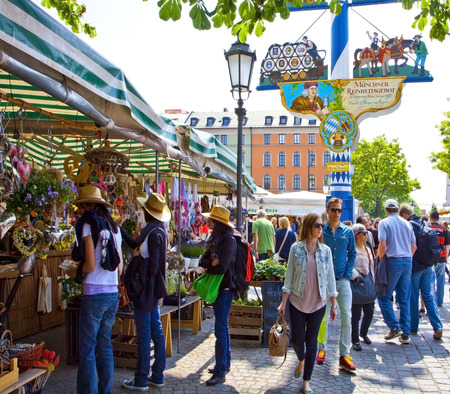 MUNICH, GERMANY; local buyers and tourists mingle together at the Viktualien Markt, open air market of food and delicacy in Munich city center. Editorial
