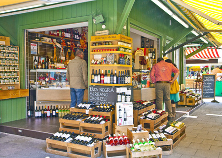 MUNICH, GERMANY. Grocery and delicacy shop at Viktualien Markt in Munich center offers daily gourmet specialties and wines to  regular buyers and tourists Editorial
