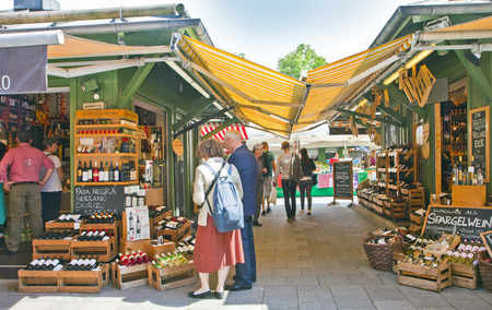 MUNICH, GERMANY. Viktualien Markt open air market in Munich center is a shopping landmark that offers daily gourmet delicacies and wines to regular buyers and tourists Editorial