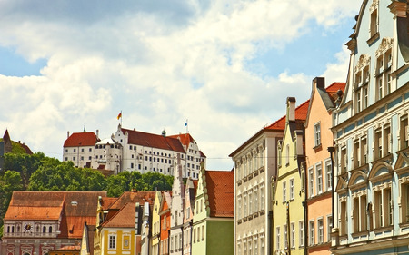 Panoramic view of Landshut, Bavarian city, with the medieval castle and an array of colorful antique buildings Stock Photo