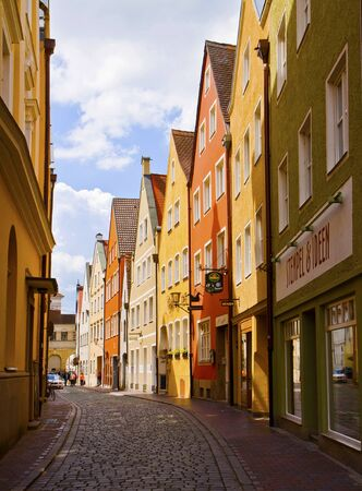 landshut: LANDSHUT, GERMANY -view of a narrow cobbled street in  Landshut center, Bavarian medieval town near Munich. Landshut was founded on 1204, the facades of its buildings maintain a characteristic Renaissance style and  bold colors Editorial