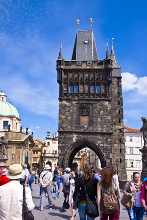 lasted: PRAGUE, CZECH REPUBLIC -  Tourists cross the Charles Bridge over the Moldau  river to the Old Town of Prague.The bridge construction begun on 1357 and lasted 70 years. Editorial