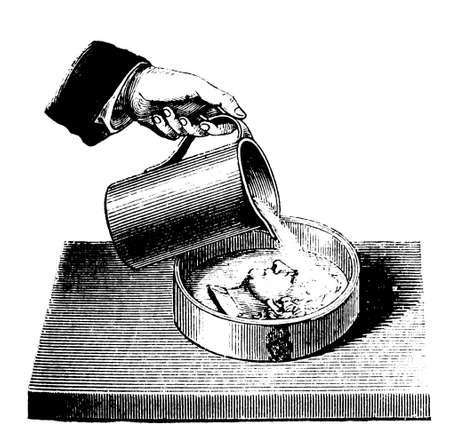 thaler: Casting the mold of a coin (Thaler) with a mixture of gypsum and water (CaSO4 + H2O) Stock Photo